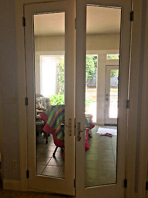 Semco French doors, glass, with brass locking hardware