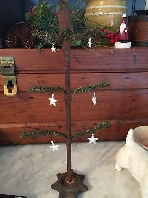 Primitive feather tree with an antique machine part Base