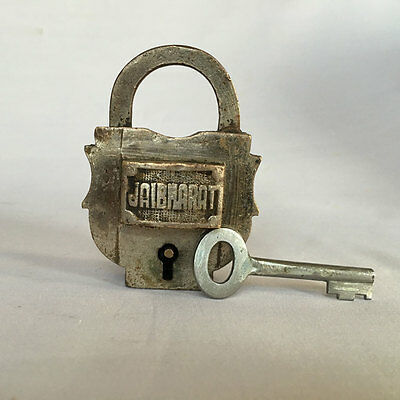 007 An old or antique solid brass padlock lock with key rich patina rarest shape