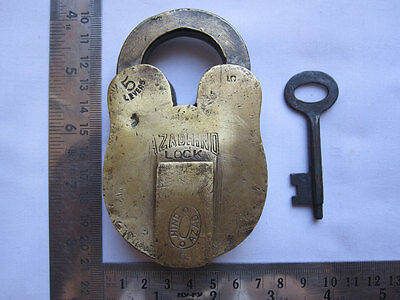 005 An old or antique solid brass padlock lock with key rich patina