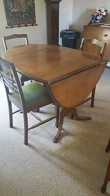 Timber Oval Dining Table With Drop Leaf Ends and Four Matching Chairs