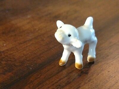 Cute vintage calf from the white cartoony cow family made by Hagen Renaker