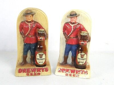 Vintage Pair Drewrys Beer Mountie Miniature Bottle Chalkware Statue wall Plaque