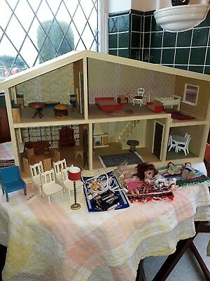 Vintage wooden dolls house c1970/80's with various items of furniture