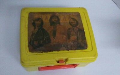 1978 bee gees lunch box with shifting image. Thermos brand plastic box.