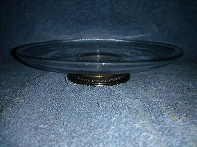 Etched glass Bowl with a sterling silver base .