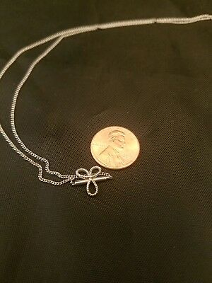 Nice 14Kt White Gold Chain With Locking Bow Pendant 2.6 Grams