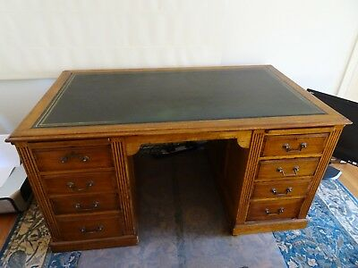 Queensland Maple double pedestal eight drawer desk with two leaves