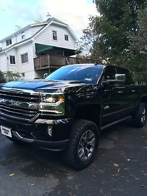 """2017 Chevrolet Silverado 1500 High Country 2017 Chevy 1500 High Country 6"""" rough Country Suspension & 35"""" BFG All Terrain"""