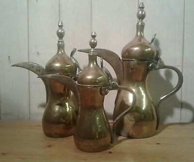 Set of 3 graduating size 19th c hand crafted omani brass dallah (coffee pots)