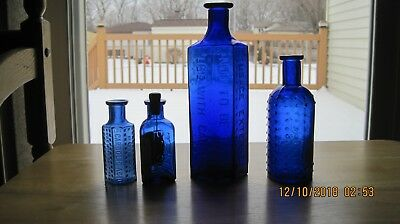 Four Cobalt Poison Bottles Including Labeled Owl Drug Co.