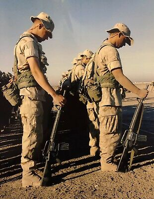 Photo of Soldiers Observing Moment of Silence - Desert Terrain - USMC?