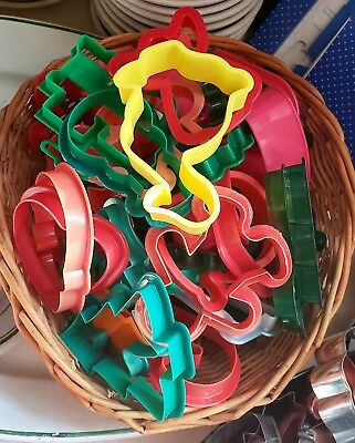 Vintage Assorted Color Cookie Cutters with nice wicker basket