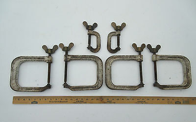 vintage industrial large cast iron G D clamps & brass butterfly wing nuts tools.