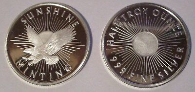 sunshine silver round 1/2 ounce (you get two coins)