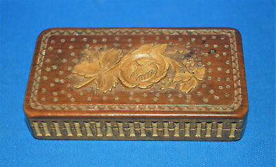 A Black Forest, Swiss carved wooden match box striker, repousse rose flower lid