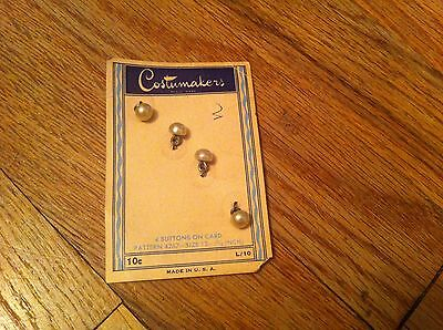 set of four vintage Costumakers brand pearl-look buttons new on card 4767 5/16""