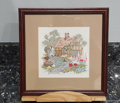 cross stitch framed picture of cottage and garden
