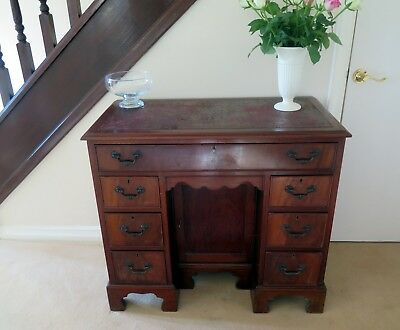 A  mahogany 20th century 7 drawer desk of small proportions