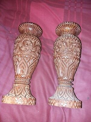 Pair of carved wooden candle sticks