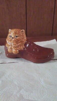 "Cat in Shoe figurine. Tan cat in brown loafer. 6""long x4"" tall. Shiny. One nick"
