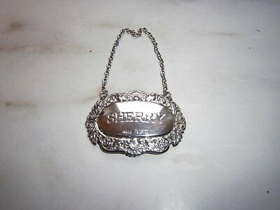 silver decanter sherry label