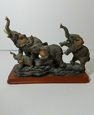 elephant family sculpture on  base  resin figurines