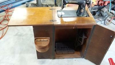 Vintage Singer Sewing Machine in Cabinet.sewing,house,cotton,old,tools,verandah.