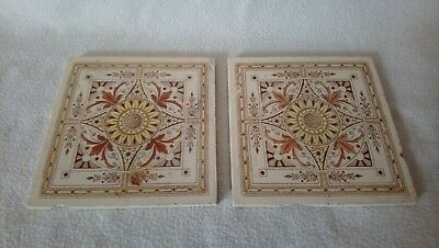 Two Ornate Vintage Ceramic Tiles In Tan Cream And Yellow