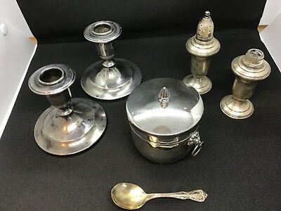 Lot# 1371.  Sterling salt and pepper shaker, candle stick holders and coaster
