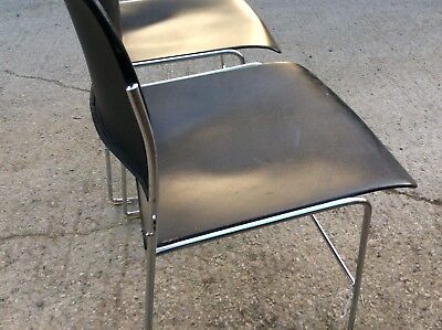 Pair of stylish metal stacking chairs
