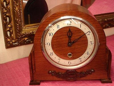Delightful 1930`s English Oak Cased, mantel clock lovely condition.