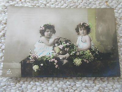 Antique postcard of pretty young girls with flowers, posted Victoria