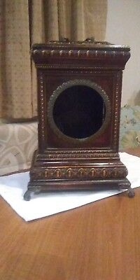 A Nice Carved Wooden Clock Case With Brass Feet