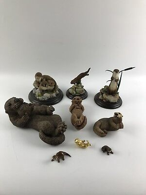 Assorted Otter Figurines Including Country Artists - lot 1293
