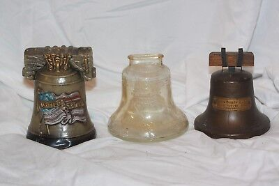 Lot of 3 Vintage Liberty Bell Coin Still Piggy Banks Metal Plastic & Glass