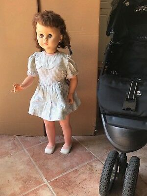 1960s life-size vintage doll in original outfit; gorgeous eyes and hair