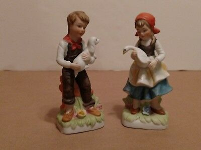 Home Interior Figurines Boy with Dog and Girl with Duck .