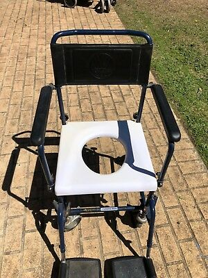 Disability over toilet chair with arm and foot rests. Vermeiren Brand