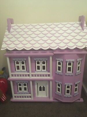 Used purple & white wooden dolls house with furniture and dolls.