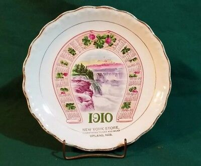 "1910 advertising 7"" calendar plate New York Store Upland Neb horseshoe & clovers"
