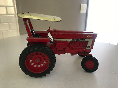 International Harvester Farmall 1066 Farm Toy Tractor and accessories