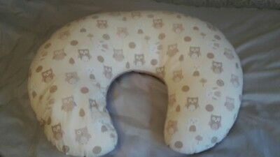 Small breastfeeding pillow with owl design.