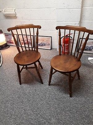 Chair: Lovely pair of solid oak one piece seat spindle backed Farmhouse Chairs