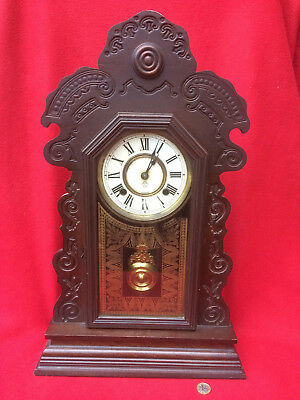 Antique Ansonia Mantle / Wall Clock requires light attention.