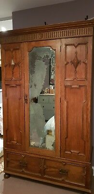 Antique Wardrobe with original mirror. Comes in 3 sections for transportation.