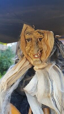 antique handmade witch with broom