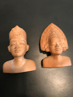 Vintage wood carvings of man and woman Bali D.E.I. 601 and 603