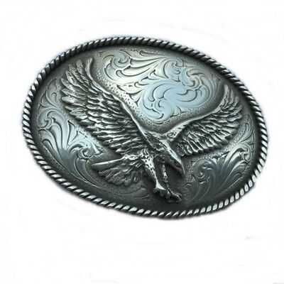 Small silver engraved western cowboy belt buckle with large Eagle Montana smith
