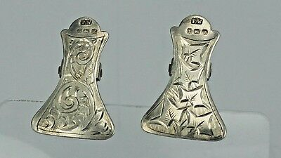 A pair of 1920's ornate silver hooked napkin serviette holders clips
